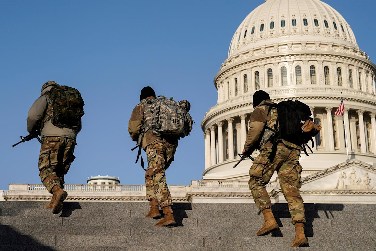 Members of the National Guard patrol at the U.S. Capitol after police warned that a militia group might try to attack the U.S. Capitol in Washington, U.S., March 4, 2021.      REUTERS/Joshua Roberts     TPX IMAGES OF THE DAY
