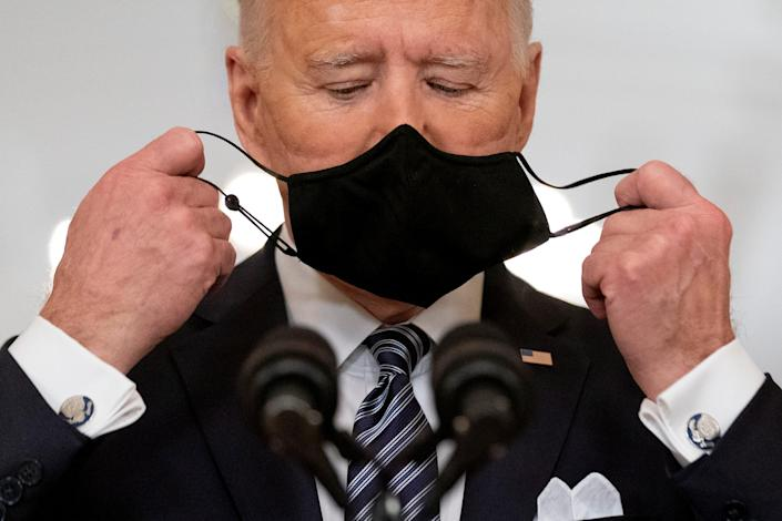 President Joe Biden takes off his mask to speak about the COVID-19 pandemic during a prime-time address from the East Room of the White House, Thursday, March 11, 2021, in Washington.