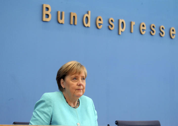 German Chancellor Angela Merkel, looks on, as she holds her annual summer news conference in Berlin, Germany, Thursday, July 22, 2021. Merkel said Thursday that new coronavirus infections in Germany are once again rising at worrying speed. She appealed to her compatriots to get vaccinated and persuade others to do so. (Wolfgang Kumm/dpa via AP)