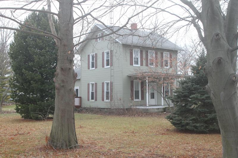 Port Clinton police say they believe 14-year-old Harley Dilly, reported missing on Dec. 21, climbed the antenna tower of this house to the roof and then entered the chimney, where his body was found Monday night.