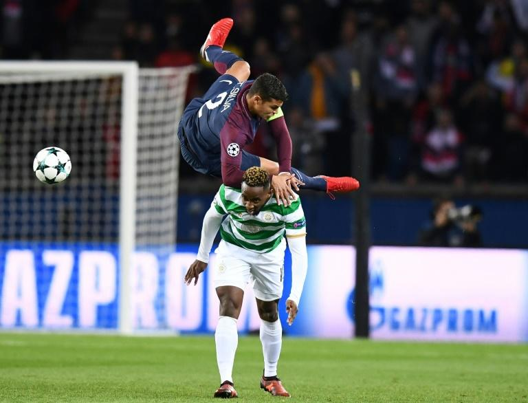 Paris Saint-Germain's defender Thiago Silva (TOP) fights for the ball with Celtic's striker Moussa Dembele during the UEFA Champions League Group B football match November 22, 2017