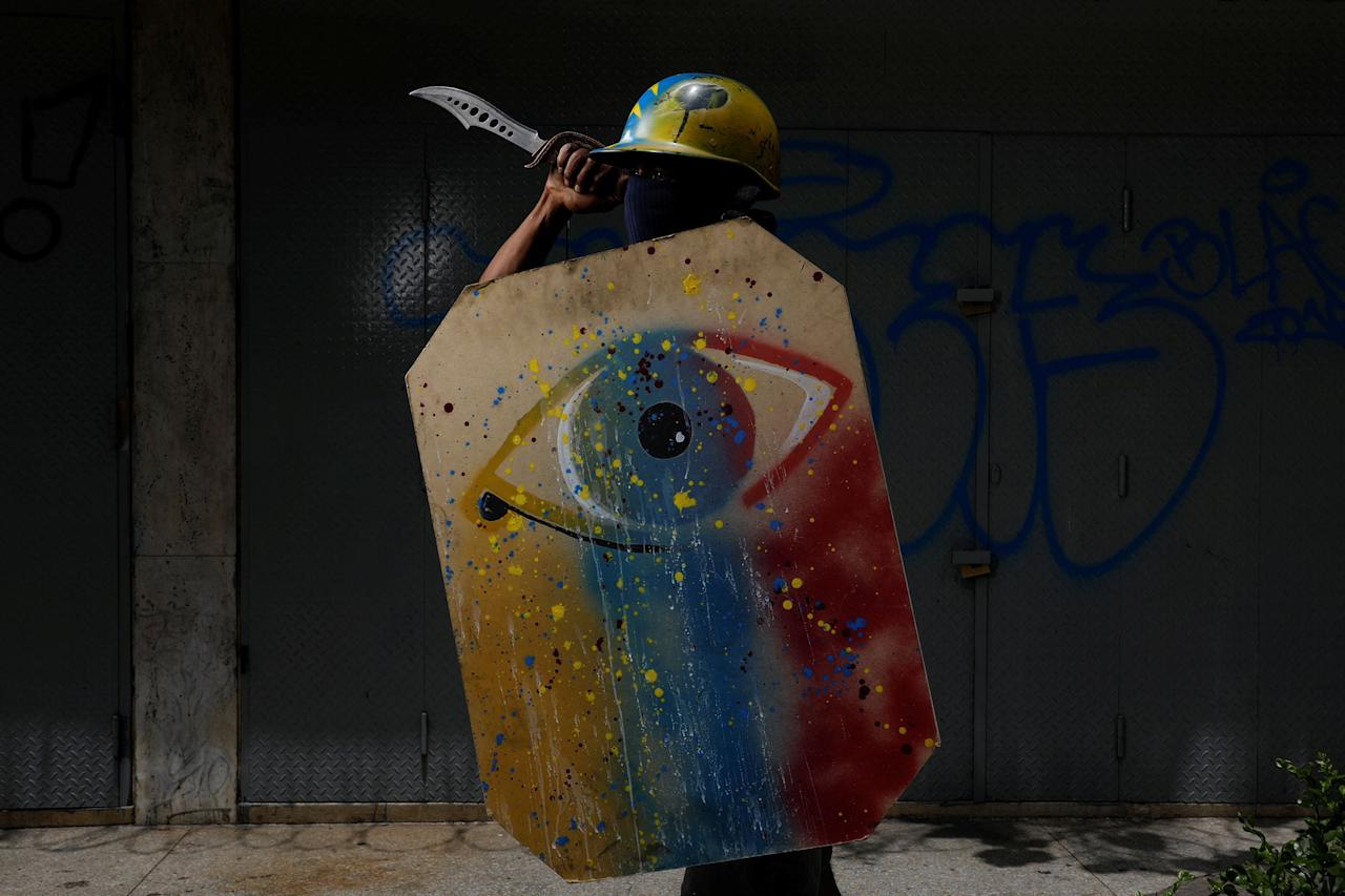 "<p>A demonstrator holding a rudimentary shield and a knife poses for a picture before a rally against Venezuelan President Nicolas Maduro's government in Caracas, Venezuela, May 27, 2017. He said: ""I protest because the situation is very tough and we are going hungry. We really need a change."" (Photo: Carlos Garcia Rawlins/Reuters) </p>"