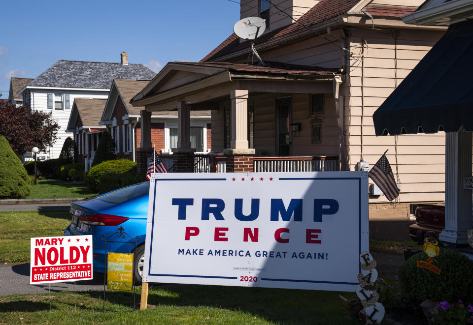 THROOP, PENNSYLVANIA - OCTOBER 9: A President Donald Trump presidential campaign sign is staked on the front lawn of a residential house October 9, 2020 in Throop, Pennsylvania. The sign is located in the politically strategic northeast Lackawanna County, near Joe Biden's hometown of Scranton, PA. (Photo by Robert Nickelsberg/Getty Images)