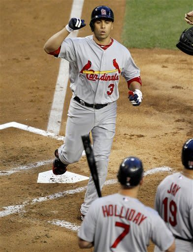 St. Louis Cardinals' Carlos Beltran (3) crosses home plate after hitting a grand slam, his second home run of the baseball game, against the Arizona Diamondbacks during the second inning Tuesday, May 8, 2012, in Phoenix. At home plate are teammates Matt Holliday (7) and Jon Jay (19). (AP Photo/Matt York)