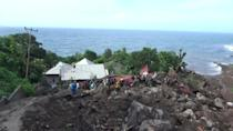 More than 100 dead after flooding in Indonesia and East Timor