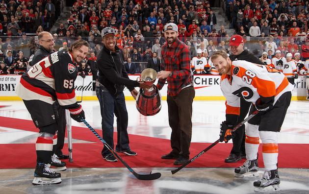 """<em>OTTAWA, ON – DECEMBER 1: CFL Grey Cup champions (L-R) Marcel Desjardins, Henry Burris, Brad Sinopoli and Rick Campbell of the Ottawa Redblacks drop the puck for a ceremonial face-off with <a class=""""link rapid-noclick-resp"""" href=""""/nhl/players/4491/"""" data-ylk=""""slk:Erik Karlsson"""">Erik Karlsson</a> #65 of the <a class=""""link rapid-noclick-resp"""" href=""""/nhl/teams/ott/"""" data-ylk=""""slk:Ottawa Senators"""">Ottawa Senators</a> and <a class=""""link rapid-noclick-resp"""" href=""""/nhl/players/4002/"""" data-ylk=""""slk:Claude Giroux"""">Claude Giroux</a> #28 of the <a class=""""link rapid-noclick-resp"""" href=""""/nhl/teams/phi/"""" data-ylk=""""slk:Philadelphia Flyers"""">Philadelphia Flyers</a> before an NHL game at Canadian Tire Centre on December 1, 2016 in Ottawa, Ontario, Canada. (Photo by Andre Ringuette/NHLI via Getty Images)</em>"""