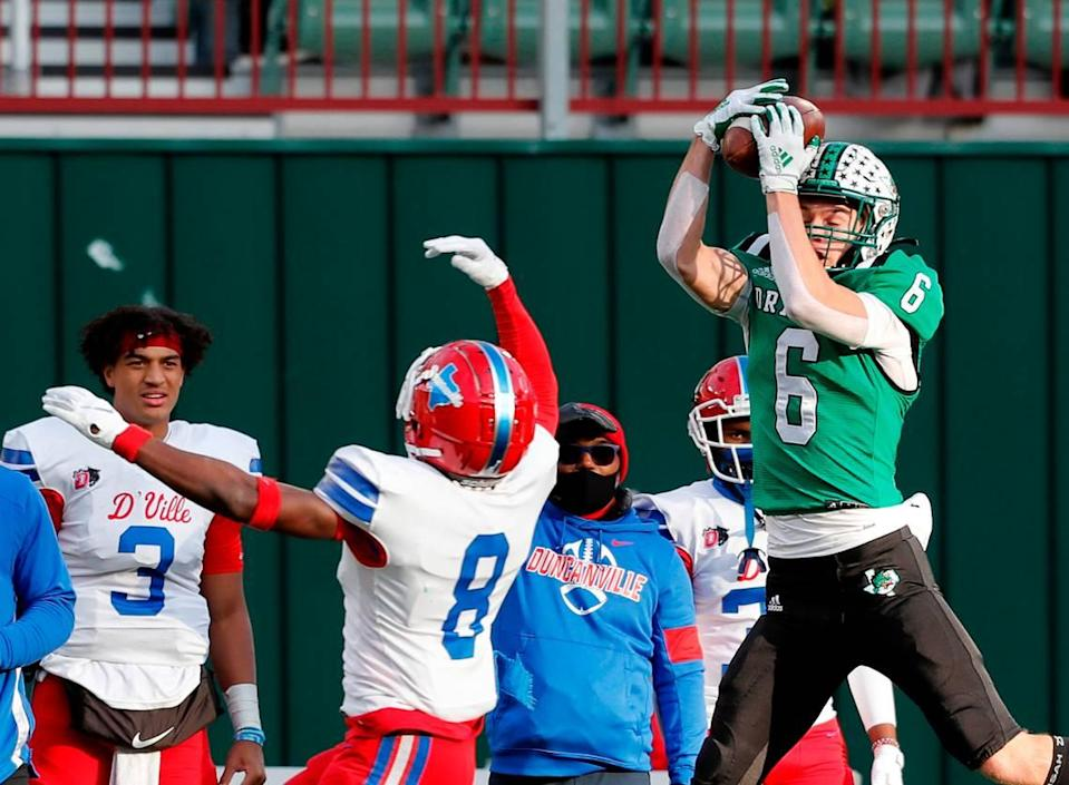 Southlake receiver Landon Samson grabs a pass in front of Duncanville linebacker Jadarius Thursby (8) during the Conference 6A Division 1 2020 state championship semi-final football game at Globe Life Park in Arlington, Texas, Saturday, Jan. 09, 2021. Duncanville led 27-21 at the half. (Special to the Star-Telegram Bob Booth)