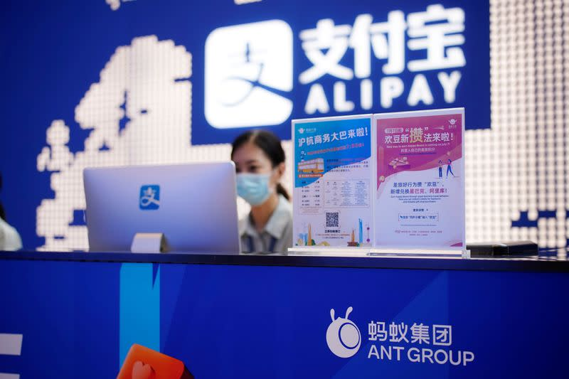 FILE PHOTO: Ant Group logo is pictured at the Shanghai office of Alipay, owned by Ant Group which is an affiliate of Chinese e-commerce giant Alibaba, in Shanghai