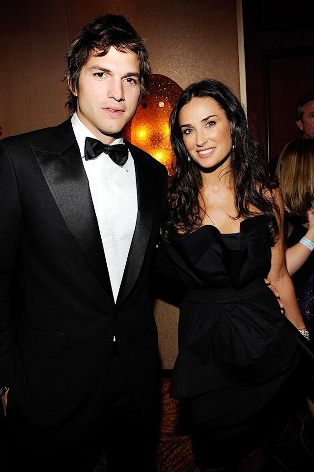 """Ashton Kutcher attended the MTV/ServiceNation event with his favorite accessory: wife Demi Moore. The ever-youthful actress looked gorgeous in a strapless Donna Karan cocktail dress. Kevin Mazur/<a href=""""http://www.wireimage.com"""" target=""""new"""">WireImage.com</a> - January 20, 2009"""