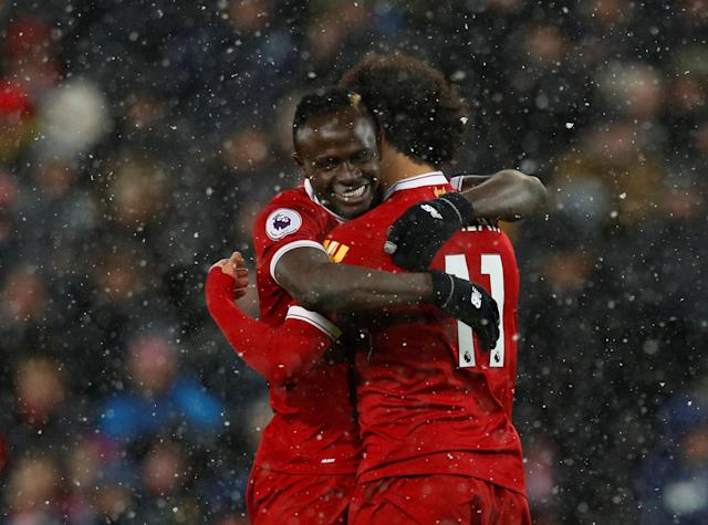 "Soccer Football - Premier League - Liverpool vs Watford - Anfield, Liverpool, Britain - March 17, 2018 Liverpool's Mohamed Salah celebrates scoring their fifth goal with Sadio Mane REUTERS/Phil Noble EDITORIAL USE ONLY. No use with unauthorized audio, video, data, fixture lists, club/league logos or ""live"" services. Online in-match use limited to 75 images, no video emulation. No use in betting, games or single club/league/player publications. Please contact your account representative for further details."