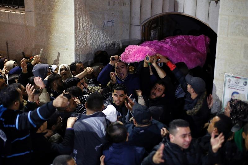 Palestinians chant slogans as they carry the body of 14-year-old Hadeel Awwad, who was shot dead on November 23 by an Israeli police officer following a stabbing attack in Jerusalem's central market (AFP Photo/Abbas Momani)