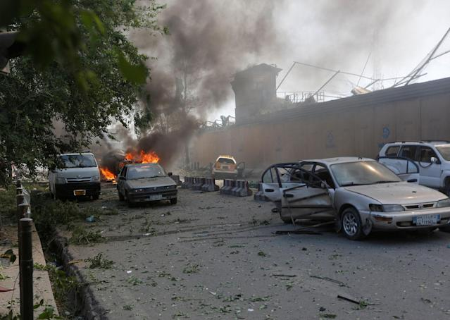 <p>Damaged cars are seen at the site of a blast in Kabul, Afghanistan May 31, 2017. (Omar Sobhani/Reuters) </p>