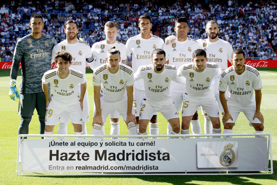 MADRID, SPAIN - OCTOBER 5: Back row: (L-R) Areola of Real Madrid, Sergio Ramos of Real Madrid, Toni Kroos of Real Madrid, Sergio Ramos of Real Madrid, Casemiro of Real Madrid, Karim Benzema of Real Madrid  Front row: (L-R) Alvaro Odriozola of Real Madrid, Gareth Bale of Real Madrid, Dani Carvajal of Real Madrid, Federico Valverde of Real Madrid, Hazard of Real Madrid  during the La Liga Santander  match between Real Madrid v Granada at the Santiago Bernabeu on October 5, 2019 in Madrid Spain (Photo by David S. Bustamante/Soccrates/Getty Images)