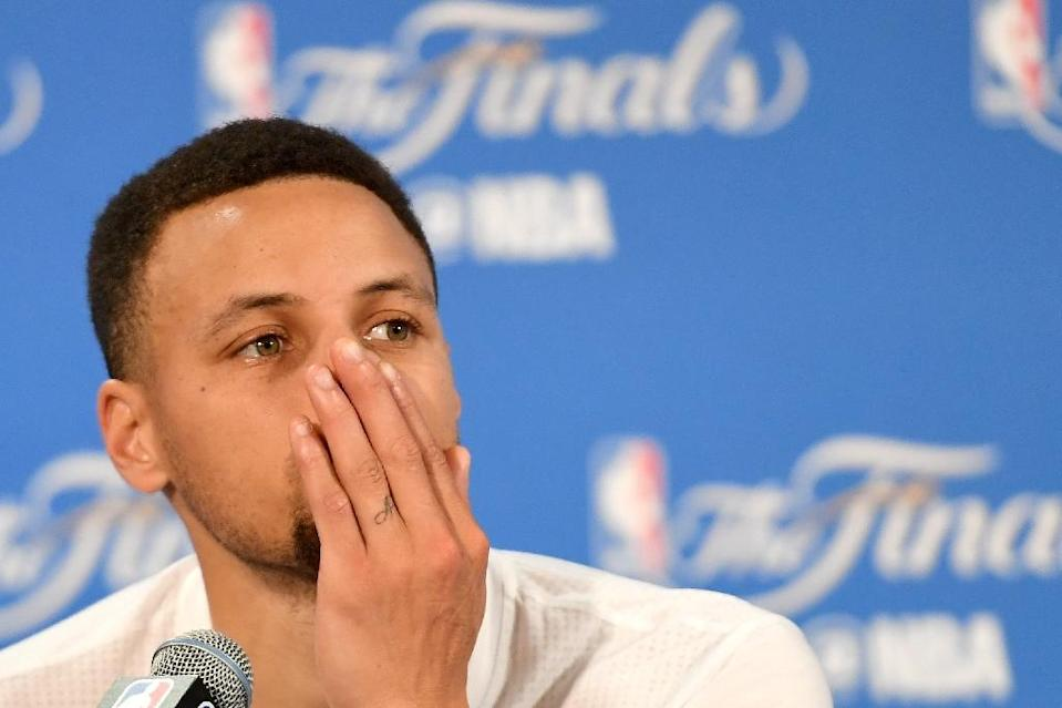 Stephen Curry of the Golden State Warriors speaks to the media after being defeated by the Cleveland Cavaliers in Game 7 of the 2016 NBA Finals, at ORACLE Arena in Oakland, California, on June 19 (AFP Photo/Thearon W. Henderson)