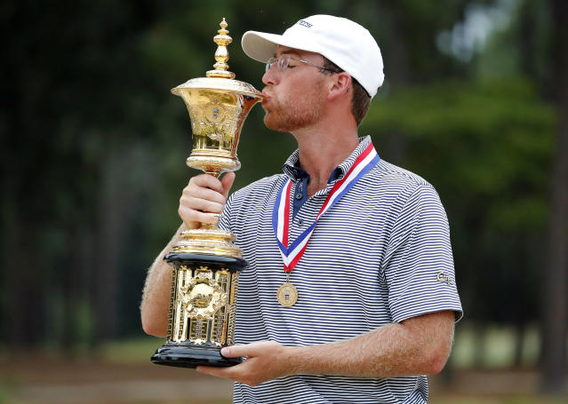 Andy Ogletree poses with the Havemeyer Trophy following his win at the USGA Amateur Golf Championship at the Pinehurst Country Club in Pinehurst, N.C., Sunday, Aug. 18, 2019. (AP Photo/Karl B DeBlaker)