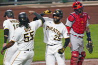 Pittsburgh Pirates' Gregory Polanco (25) celebrates with Josh Bell (55) and ColinMoran, left, after crossing home plate next to St. Louis Cardinals catcher Yadier Molina, right, on a three-run home run off Cardinals relief pitcher Austin Gomber during the fourth inning of a baseball game in Pittsburgh, Thursday, Sept. 17, 2020. (AP Photo/Gene J. Puskar)