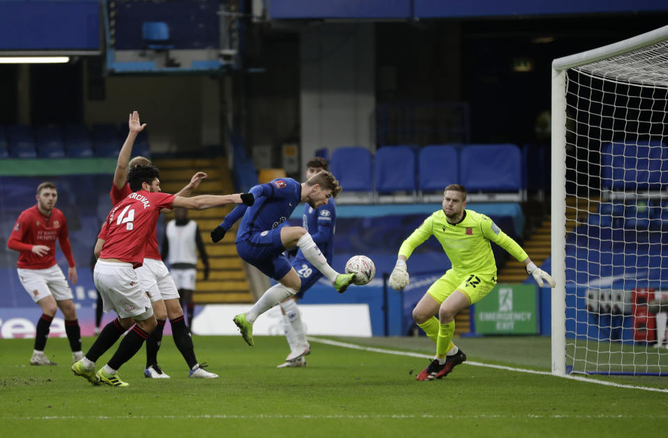 Chelsea's Timo Werner, centre, scores his side's second goal during the English FA Cup third round soccer match between Chelsea and Morecambe at Stamford Bridge Stadium in London, Sunday, Jan. 10, 2021. (AP Photo/Matt Dunham)