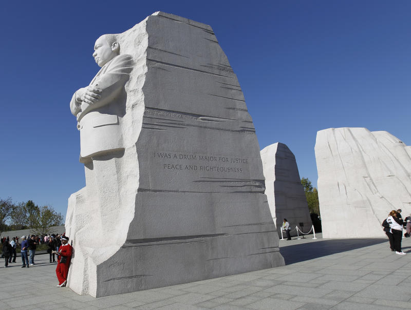 A visitor leans on the Martin Luther King Jr. Memorial in Washington on Saturday, Oct. 15,  2011. President Barack Obama is to speak at the dedication of the memorial to the civil rights pioneer Sunday. (AP Photo/Jose Luis Magana)