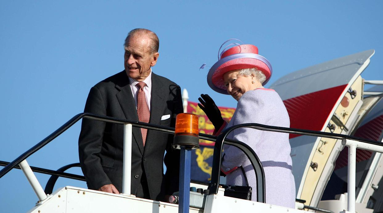 Queen Elizabeth II with the Duke of Edinburgh at Heathrow Airport before boarding a plane ahead of the royal visit to eastern Europe.
