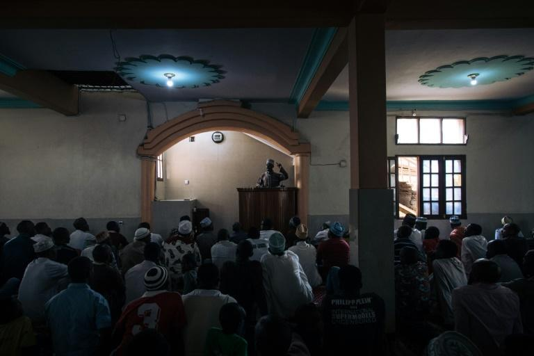 Muslim worshippers gather for Friday prayers at a mosque in Beni