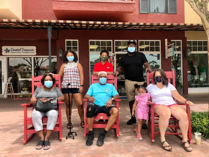 The Palmer Family from Raleigh, North Carolina sits in rocking chairs for a family photo. The three generations of family members wore masks inside and out on Hilton Head Island during their weeklong vacation during the coronavirus.