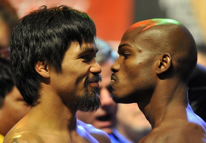 Boxers Manny Pacquiao (L) of the Philippines and Timothy Bradley of US stand face to face during the weigh-in session at the MGM Grand Arena in Las Vegas, Nevada on June 08,2012.  Pacquiao and Bradley will fight on June 9.      AFP PHOTO / JOE KLAMARJOE KLAMAR/AFP/GettyImages