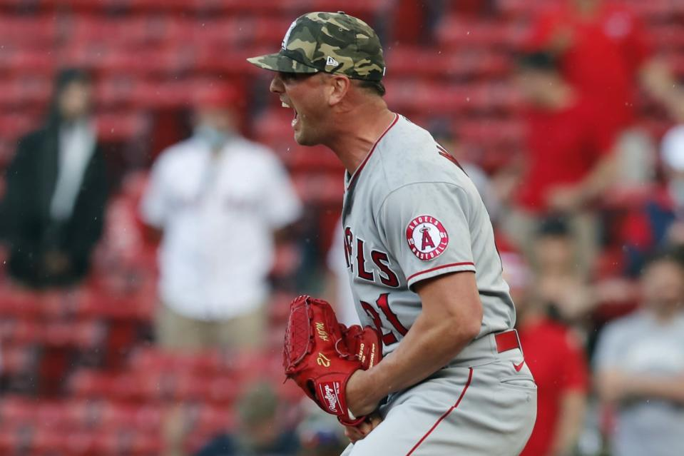 Los Angeles Angels' Mike Mayers reacts after striking out Boston Red Sox's Michael Chavis to end the baseball game during the ninth inning, Sunday, May 16, 2021, in Boston. (AP Photo/Michael Dwyer)