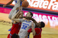 Creighton center Ryan Kalkbrenner (32) fights for a rebound against St. John's forward Josh Roberts (1) and St. John's guard Greg Williams Jr. (4) in the first half of an NCAA college basketball game Saturday, Jan. 9, 2021, in Omaha, Neb. (AP Photo/John Peterson)