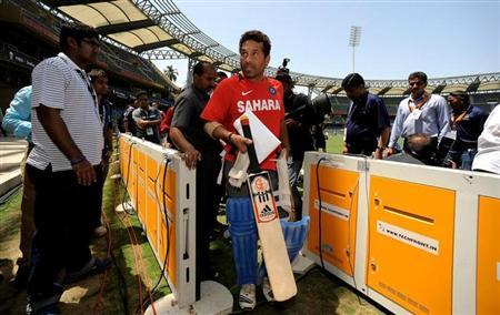 Sachin Tendulkar walks to the dressing room after a training session at the Wankhede Stadium in Mumbai April 1, 2011. REUTERS/Philip Brown/Files