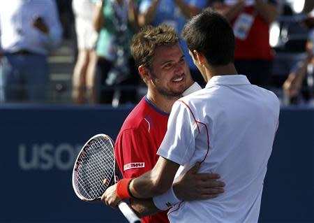 Novak Djokovic of Serbia is congratulated by Stanislas Wawrinka of Switzerland (L) after Djokovic won their men's semi-final match at the U.S. Open tennis championships in New York September 7, 2013. REUTERS/Eduardo Munoz