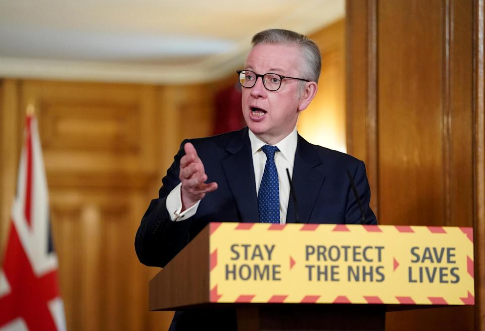 Michael Gove speaking during a media briefing in Downing Street (PA)