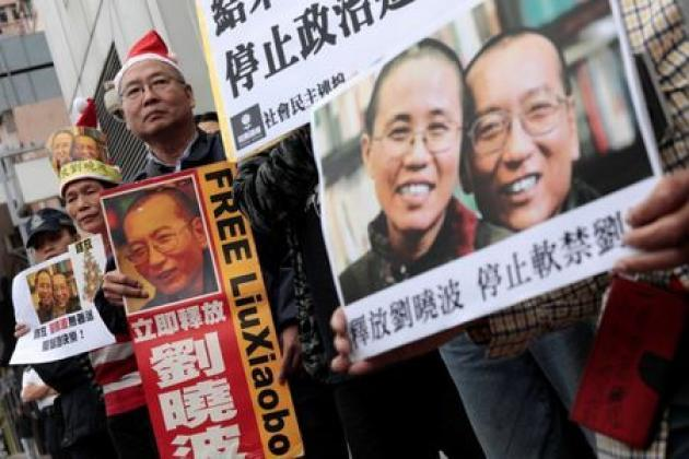 France urges China to free activist Liu, no comment if ready to welcome him