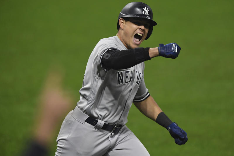 New York Yankees' Gio Urshela celebrates while running the bases after hitting a grand slam off Cleveland Indians relief pitcher James Karinchak in the fourth inning of Game 2 of an American League wild-card baseball series Wednesday, Sept. 30, 2020, in Cleveland. (AP Photo/David Dermer)