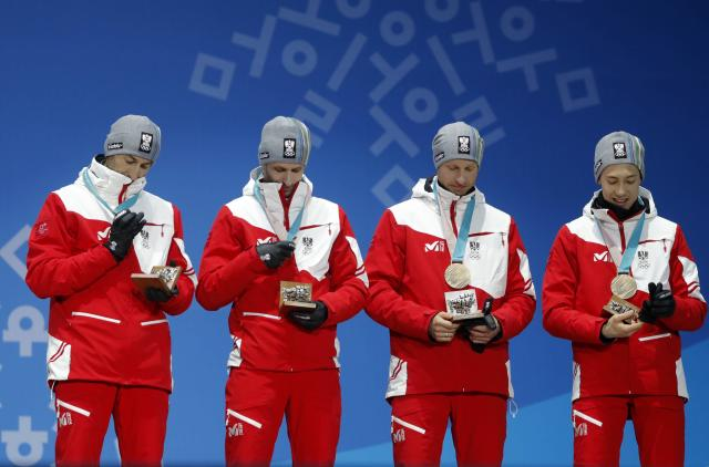 Medals Ceremony - Nordic Combined Events - Pyeongchang 2018 Winter Olympics - Men's Team 4 x 5 km - Medals Plaza - Pyeongchang, South Korea - February 23, 2018 - Bronze medalists Wilhelm Denifl, Lukas Klapfer, Bernhard Gruber and Mario Seidl of Austria on the podium. REUTERS/Eric Gaillard