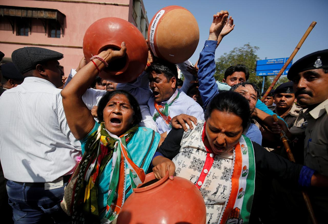 <p>Activists of India's Congress party carry earthen pots as they scuffle with police during a protest against the shortage of drinking water outside the municipal corporation office in Ahmedabad, India May 25, 2017. REUTERS/Amit Dave </p>