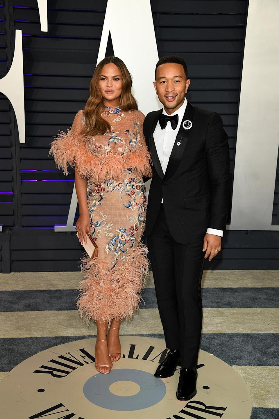 <p>Chrissy is wearing a Marchesa dress from the label's pre-Autumn 2019 collection, while John is wearing a Gucci tuxedo. <em>[Photo: Getty]</em> </p>