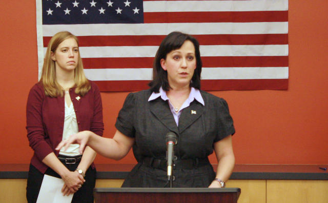 Maj. Mary Jennings Hegar, accompanied by Marine Capt. Zoe Bedell, speaking in San Francisco. (Photo: Gigi Pandian, ACLU of Northern California/AP)