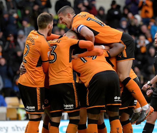 "Soccer Football - Championship - Wolverhampton Wanderers vs Burton Albion - Molineux Stadium, Wolverhampton, Britain - March 17, 2018 Wolves' Benik Afobe celebrates scoring their third goal with teammates Action Images/Alan Walter EDITORIAL USE ONLY. No use with unauthorized audio, video, data, fixture lists, club/league logos or ""live"" services. Online in-match use limited to 75 images, no video emulation. No use in betting, games or single club/league/player publications. Please contact your account representative for further details."