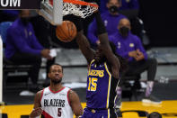 Los Angeles Lakers center Montrezl Harrell (15) dunks the ball during the first half of an NBA basketball game against the Portland Trail Blazers Friday, Feb. 26, 2021, in Los Angeles. Portland Trail Blazers guard Rodney Hood (5) is at left. (AP Photo/Mark J. Terrill)