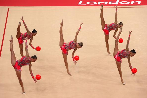 LONDON, ENGLAND - AUGUST 12:  Italy perform with the ball during the Group All-Around Rhythmic Gymnastics Final Rotation on Day 16 of the London 2012 Olympic Games at Wembley Arena on August 12, 2012 in London, England.  (Photo by Ronald Martinez/Getty Images)
