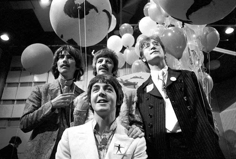 Photo of BEATLES, George Harrison, Paul McCartney, Ringo Starr, John Lennon posed, group shot at press conference before performing All You Need Is Love.