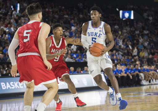 Duke Blue Devils' R.J. Barrett, right, drives to the basket as McGill Redmen's Alex Paquin (5) and Avery Cadogan (9) defend during first half exhibition basketball action in Laval, Quebec, Sunday, Aug. 19, 2018. (Graham Hughes/The Canadian Press via AP)