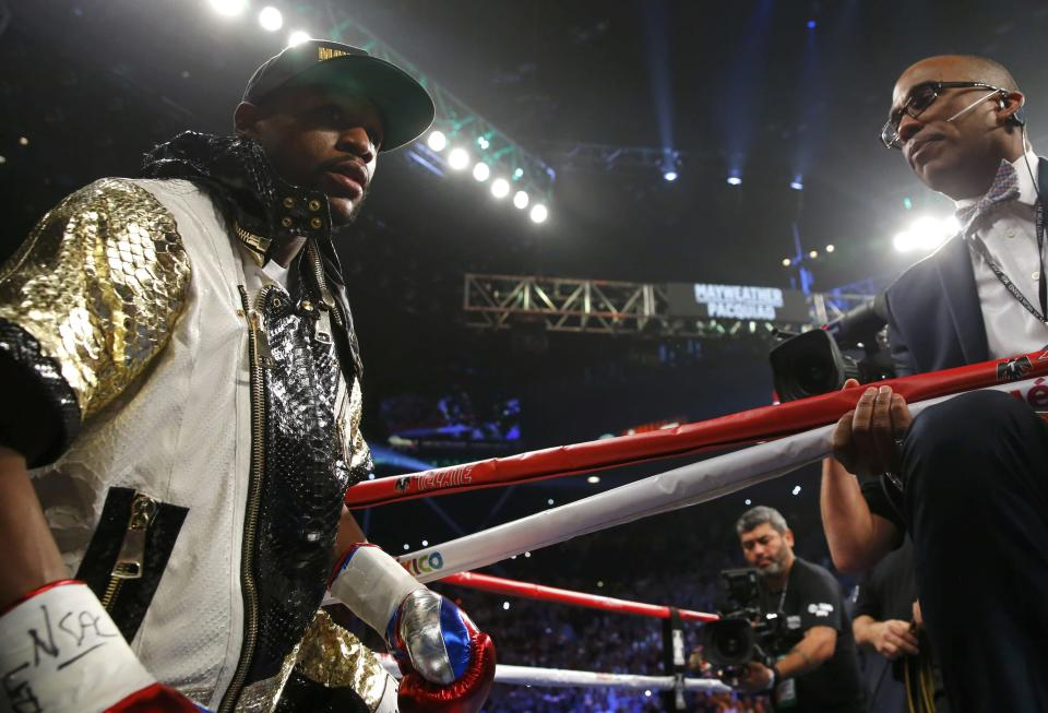 Floyd Mayweather Jr. of the U.S. arrives in the ring to face Manny Pacquiao of the Philippines ahead of their welterweight WBO, WBC and WBA (Super) title fight in Las Vegas, Nevada, May 2, 2015. REUTERS/Steve Marcus