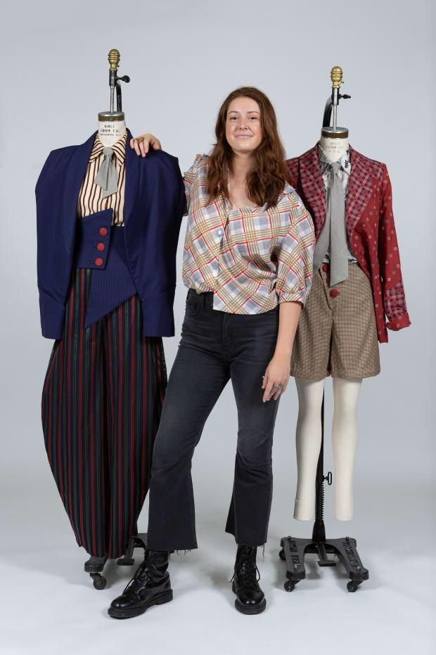 <em>Georgianna Wells, a fashion design student at the Fashion Institute of Technology, with her winning garments designed for Katherine from 'Newsies.' Photo: Courtesy of FIT</em>