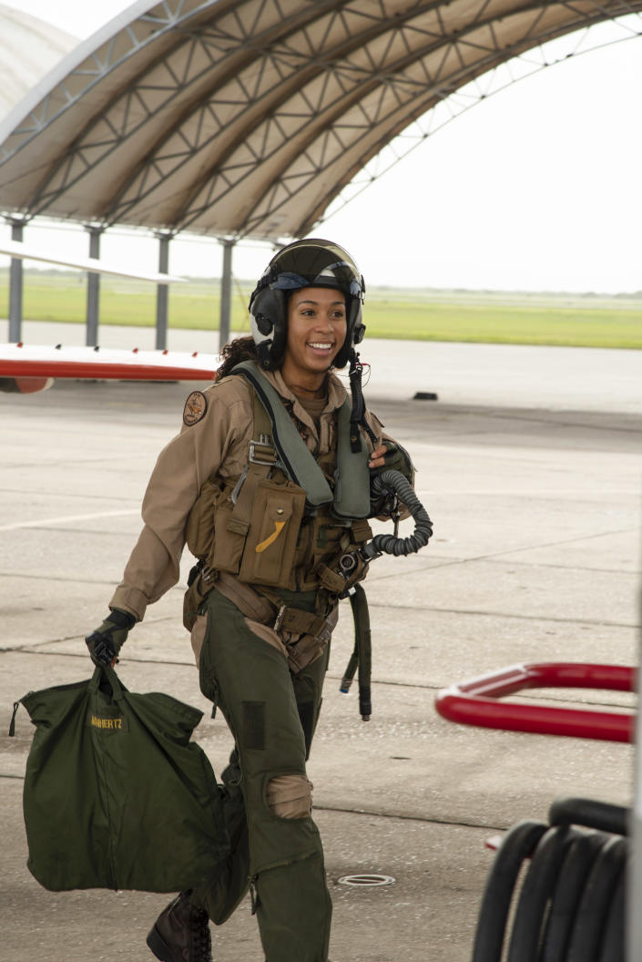 Student Naval Aviator Lt. j.g. Madeline Swegle, assigned to the Redhawks of Training Squadron (VT) 21 at Naval Air Station Kingsville, Texas, exits a T-45C Goshawk training aircraft following her final flight to complete the undergraduate Tactical Air (Strike) pilot training syllabus, July 7. Swegle is the U.S. Navy's first known Black female strike aviator and will receive her Wings of Gold during a ceremony July 31. | U.S. Navy photo by Anne Owens/Released