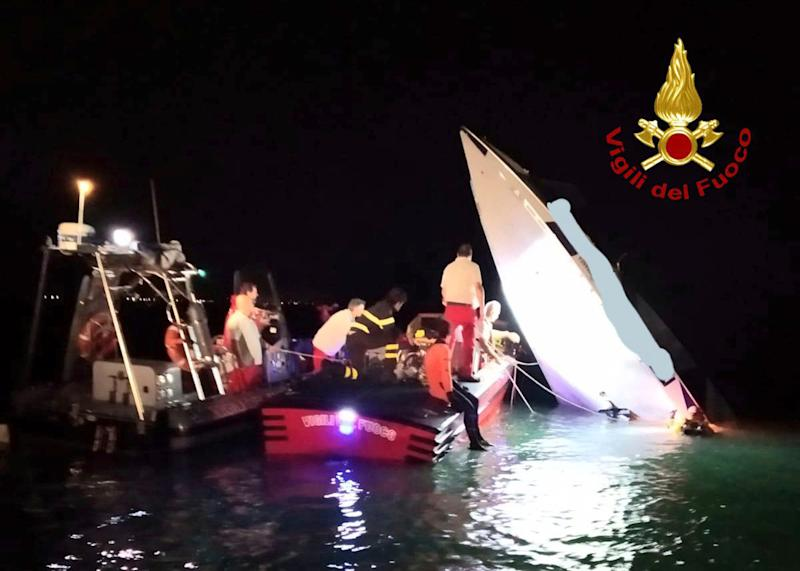 This image provided by firefighters shows the wreckage of a racing boat that allegedly smashed into a dam at the entrance of the Venice laguna, Italy, late Tuesday, Sept. 17, 2019.