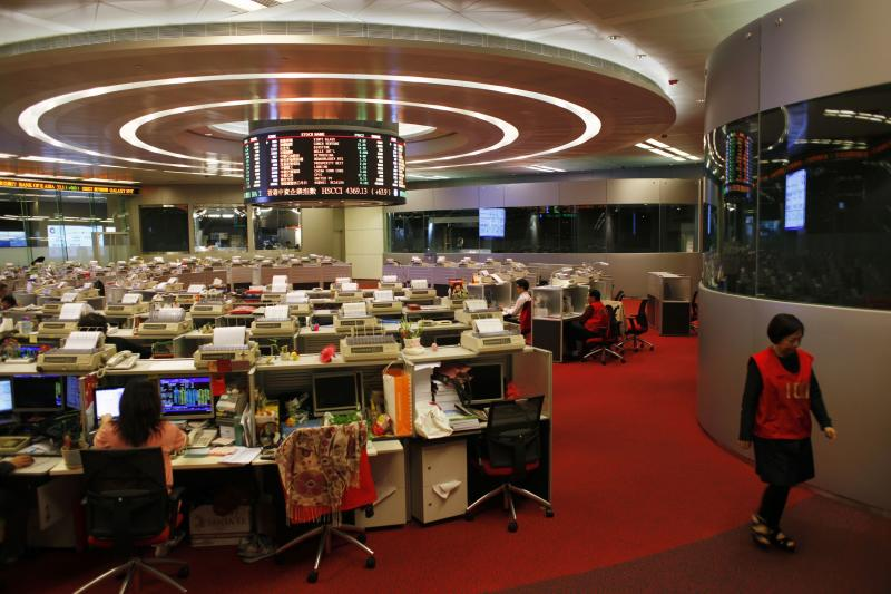 A trader walks inside the trading hall during afternoon trading at the Hong Kong Stock Exchange