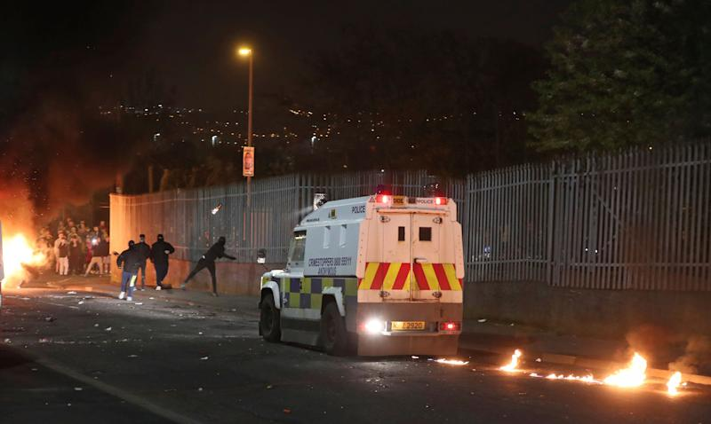 Petrol bombs are thrown at police in Creggan, Londonderry, in Northern Ireland, Thursday, April 18, 2019. (Niall Carson/PA via AP)