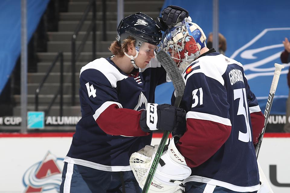 DENVER, COLORADO - FEBRUARY 02: Goaltender Philipp Grubauer #31of the Colorado Avalanche celebrates a win against the Minnesota Wild with teammate Bowen Byram #4 at Ball Arena on February 02, 2021 in Denver, Colorado. The Avalanche defeated the Wild 2-1. (Photo by Michael Martin/NHLI via Getty Images)