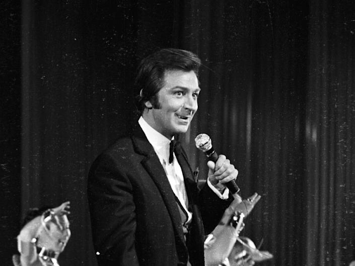<p>Des O'Connor at a rehearsal for a Royal Command performance at the London Palladium in 1969</p>Getty